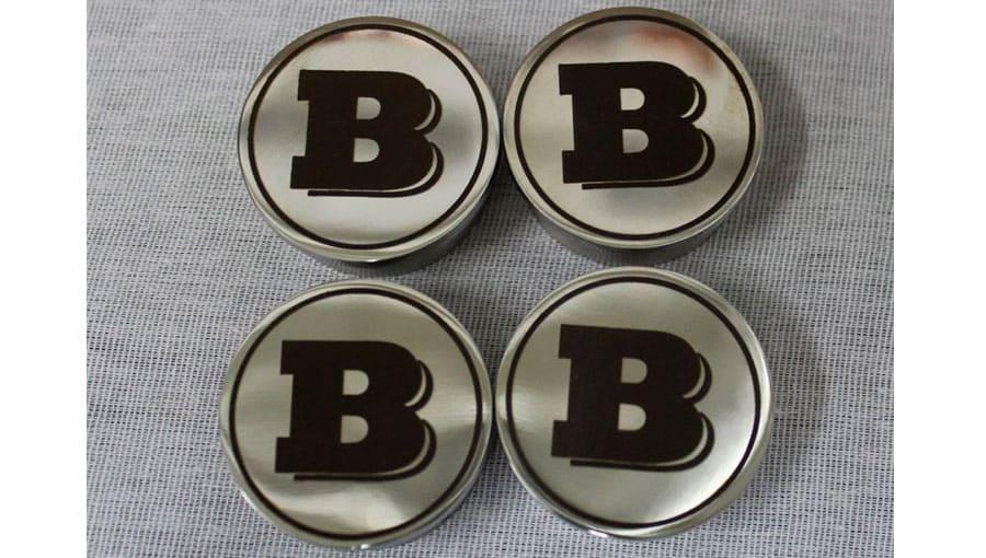 Лазерная гравировка на сувенирных металлических кнопках